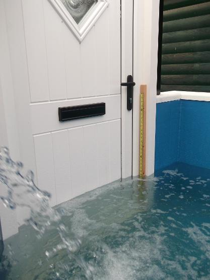 StormMeister Flood Door undergoing Extreme Testing in Simulated Flood Conditions. StormMeister Flood Doors are available & Flood Doors From the Door Factory.